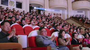 In this photo provided by the North Korean government, North Korean leader Kim Jong-un claps with his wife Ri Sol-ju (third from right) and his aunt Kim Kyong-hui (second from right) as they attend a concert celebrating Lunar New Year's Day in Pyongyang.