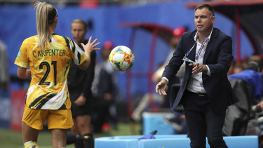 Matildas coach Ante Milicic passes the ball to Ellie Carpenter.