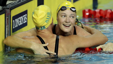 At the finish: Australia's Cate Campbell embraces her sister Bronte.