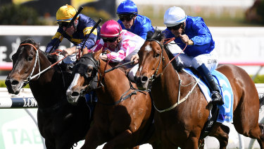 Late swoop: Hugh Bowman rides Deprive (right) to victory in the Sydney Stakes at Royal Randwick.