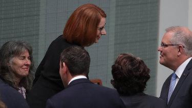 Prime Minister Scott Morrison greets former prime minister Julia Gillard, who established the commission.
