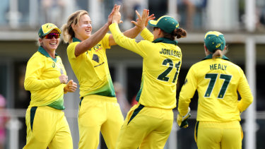 Devastating: Ellyse Perry (centre) claimed seven wickets against England.
