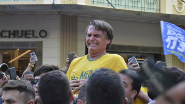 Presidential candidate Jair Bolsonaro grimaces right after being stabbed.