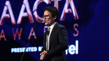 Damon Herriman presents the AACTA Award for best short documentary during the 2019 AACTA Awards.