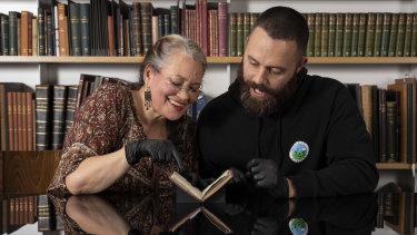'Humbling': Melissa Jackson and Raymond Ingrey reading one of the notebooks.