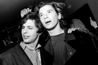 Director Richard Lowenstein, left, with Michael Hutchence in 1986. The pair made many music videos together, plus the feature Dogs in Space.