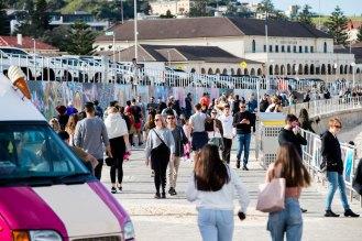 Crowds flocked to the grass and walkways at Bondi Beach on Sunday.