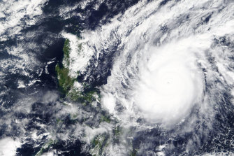 A typhoon locally known as Goni moving around the Philippines.