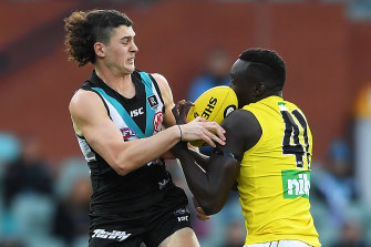 Richmond's Mabior Chol, right, in action against Port Adelaide on Saturday.
