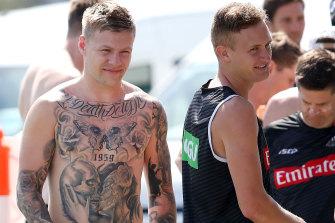 Jordan De Goey (left) is back for the Pies.