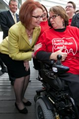 Then Prime Minister Julia Gillard shares a laugh with Lynne Foreman as the NDIS takes shape. Both parties signed up to the social initiative.