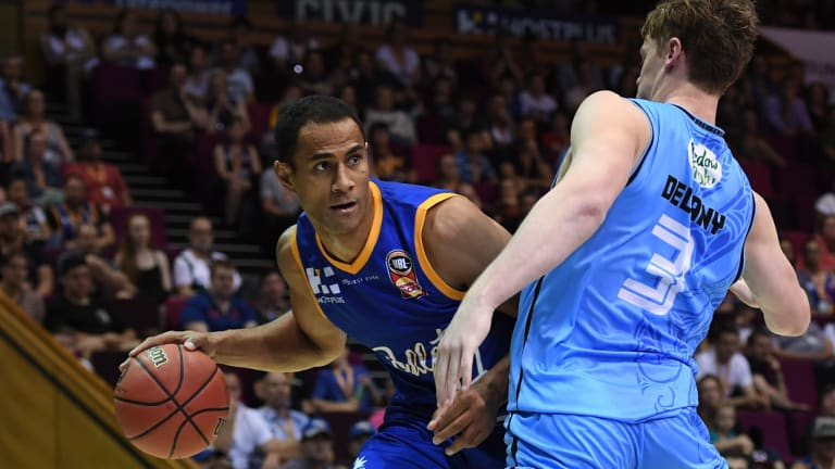 Mika Vukona of the Bullets (left) is blocked Finn Delany of the Breakers during the Round 5 NBL match at the Brisbane Convention and Entertainment Centre in Brisbane on Sunday.