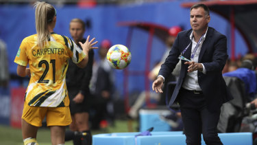 Matildas coach Ante Milicic passes the ball to Ellie Carpenter.