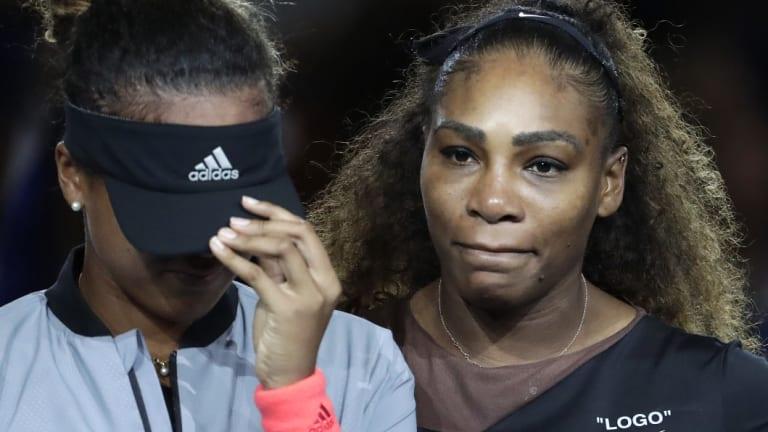 Serena Williams hugs winner Naomi Osaka after a controversial US Open final.