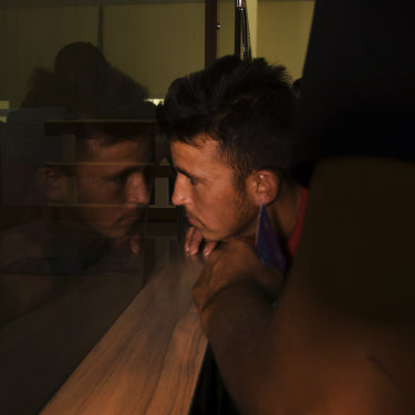 Unaccompanied minor Asdullah, 17, being processed by Afghan officials at Zero Point.