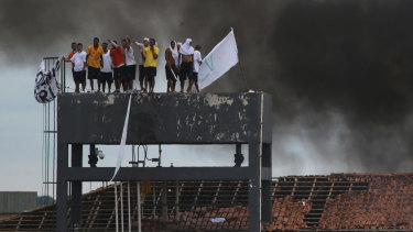 Inmates at the Puraquequara prison in Manaus, Brazil, stand on a water tower as they protest against bad conditions and restrictions on family visits put in place to curb the spread of the coronavirus.