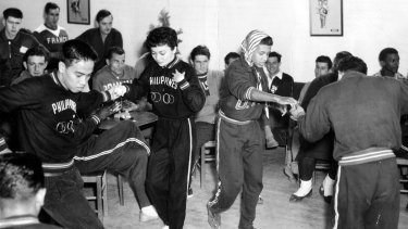 Athletes from around the world dance in the 1956 Olympic Village, West Heidelberg.