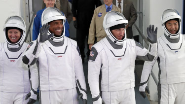 NASA astronauts, from left, Shannon Walker, Victor Glover, and Michael Hopkins and Japan Aerospace Exploration Agency astronaut Soichi Noguchi.