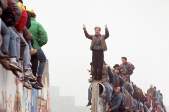 Berliners celebrate on top of the wall on Sunday, November 12, 1989.