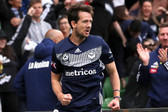 Melbourne Victory striker Robbie Kruse celebrates after opening the scoring against Newcastle.