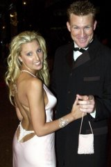 Tania Buckley in the unforgettable thong dress with her husband Nathan Buckley at the Brownlows in 2001.