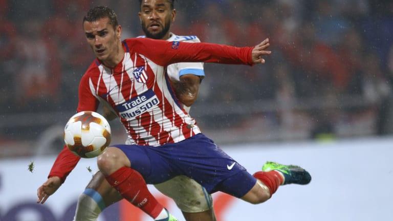 Atletico's Antoine Griezmann scores his second goal against Marseille.