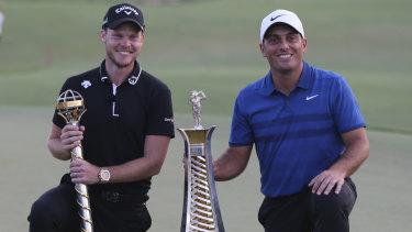 Spoils: Englishman Danny Willett (left) and Italian Francesco Molinari with their respective trophies in Dubai last year.