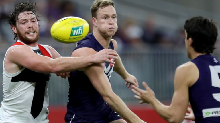 Jack Steven battles Docker Brandon Matera, who was busy near goal all night at Optus Stadium.