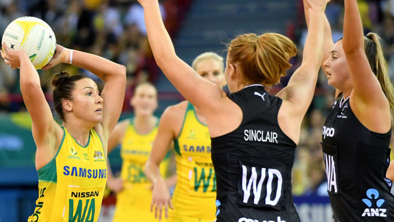 Spotting the pass: Kelsey Browne looks for an outlet against the Silver Ferns.