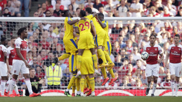 Palace's players celebrate after James McArthur scored his side's third goal to seal the win over Arsenal.