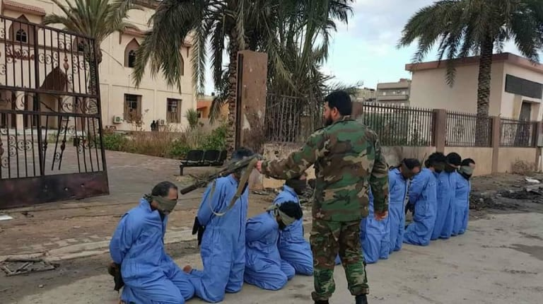 A photo published in the Libya Observer purportedly showing Mahmoud al-Werfalli committing summary executions in Benghazi in retaliation for two car bombings in January, 2018.