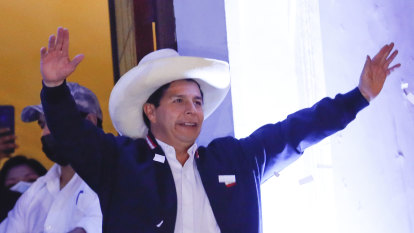 Son of illiterate peasants defeats political royalty in Peru election