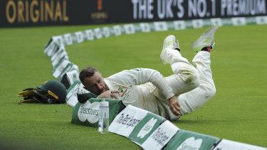 Former Test wicketkeeper Matthew Wade giving his all in the field.