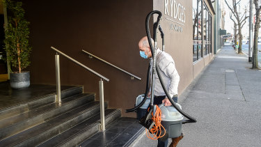 Leaked emails this week revealed patient zero was not a security guard but a night manager working at the Rydges Hotel in May. Pictured is a worker from a cleaning company.