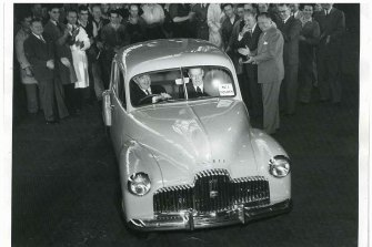 Harold Bettle, then managing director of GMH, drives the first production Holden off the assembly line in Fishermans Bend.