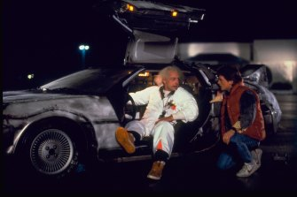 Michael J Fox and Christopher Lloyd with their time-travelling DeLorean in <i>Back To The Future</i>.