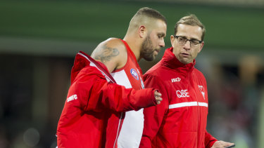 Lance Franklin (left), seen here with Swans football manager Charlie Gardiner, has suffered multiple hamstring issues this season.