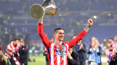 Superstar: Fernando Torres with the Europa League trophy in May.