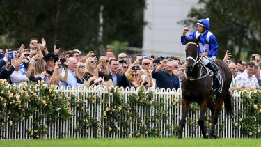 Will we ever see her likes again?: Hugh Bowman and Winx soak up the adulation of the crowd on Golden Slipper day at Rosehill.