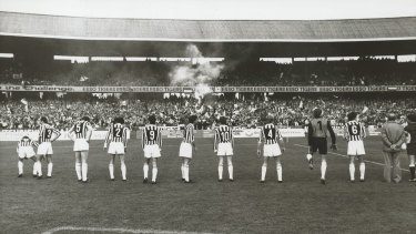 Juventus players line up before their match against Australia at the MCG.
