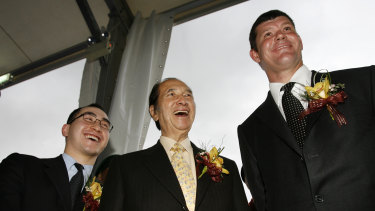 """Lawrence Ho (left), Stanley Ho (centre) and James Packer at the opening of the Crown-Melco """"City of Dreams"""" casino in Macau in 2006."""