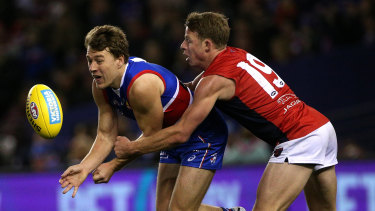 Best of the best: Bulldog Jack Macrae gets tackled by Mitch Hannan of the Demons.