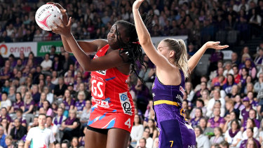 NSW's Sam Wallace holds off Kim Jenner to take a pass.
