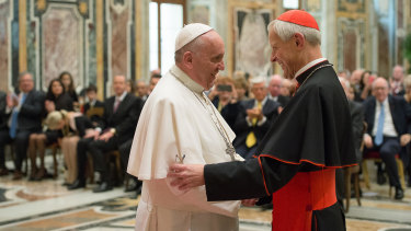 Pope Francis, left, talks with  Cardinal Donald Wuerl, during a visit to the Vatican.