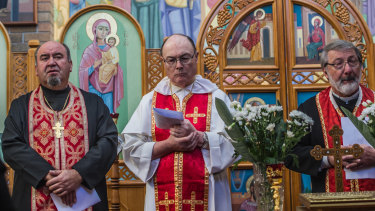 Prayer service for the innocent victims of Malaysian Airlines Flights MH17 held at Volodymyr's Ukrainian Catholic Church with service conducted by Father Wolodymyr Kalinecki, Father Lawrence Foote and Father Michael Solomko.
