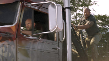 Jason Statham as Deckard Shaw (driving) and Dwayne Johnson as Luke Hobbs in the latest instalment of Fast & Furious.