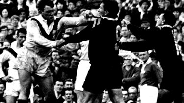 Battle of Brisbane ... Players from both sides come to blows.