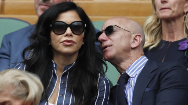 Jeff Bezos with Lauren Sanchez at Wimbledon in July last year. Her brother is fighting the Amazon billionaire in court.