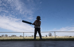 Four year old Logan Dowell playing cricket at Tempy.