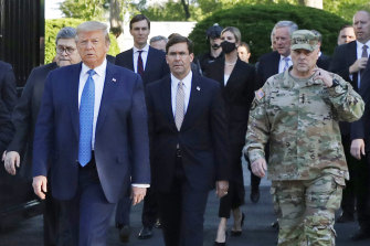 Milley, right, said he felt Trump used him as part of a photo op in his walk across Lafayette Square in June 2020.